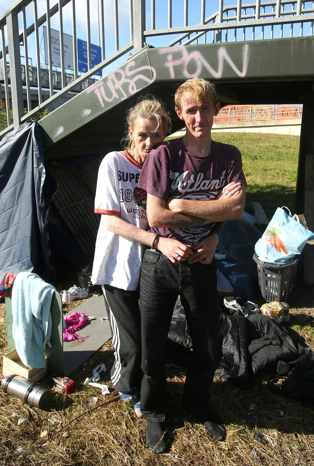 Sinead Cuthbert and Gavin Quinn who are living in a tent under a bridge spanning the M50 Picture: Damien Eagers