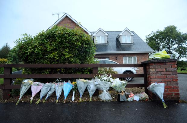 Floral tributes and messages left outside the Hawe family home in Co Cavan Picture: Caroline Quinn