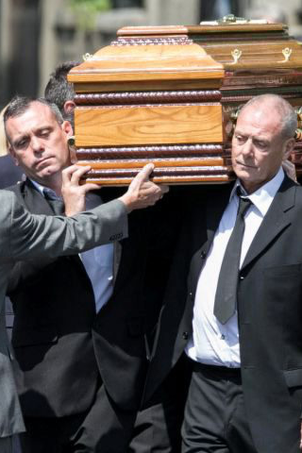 Jonathan and John Hutch carry coffin