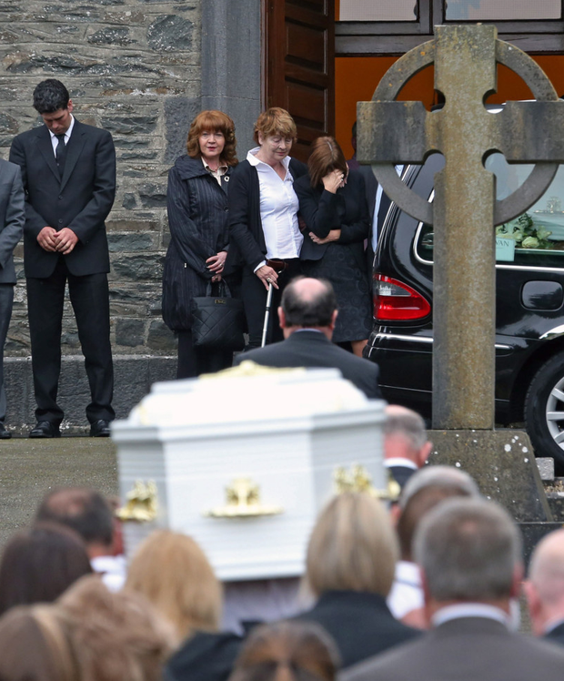 The coffin of one of the Hawe brothers outside the church Photo: Colin Keegan, Collins Dublin