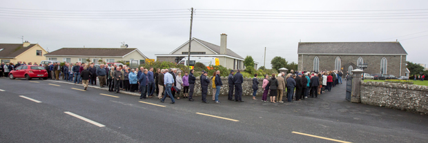 Mourners at the funeral mass of Caitríona Lucas in Liscannor, County Clare.