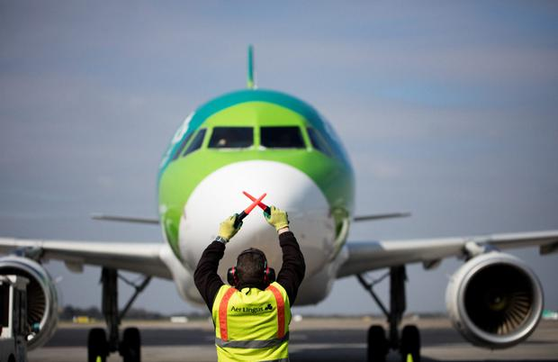 An Aer Lingus plane is guided into Dublin Airport