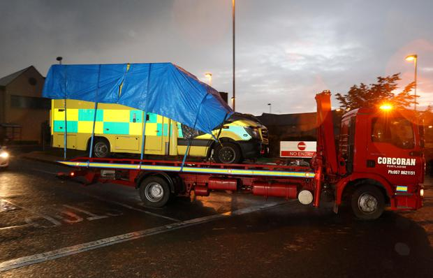 The ambulance which exploded at Naas General hospital killing one man, is removed from the scene at the hospital