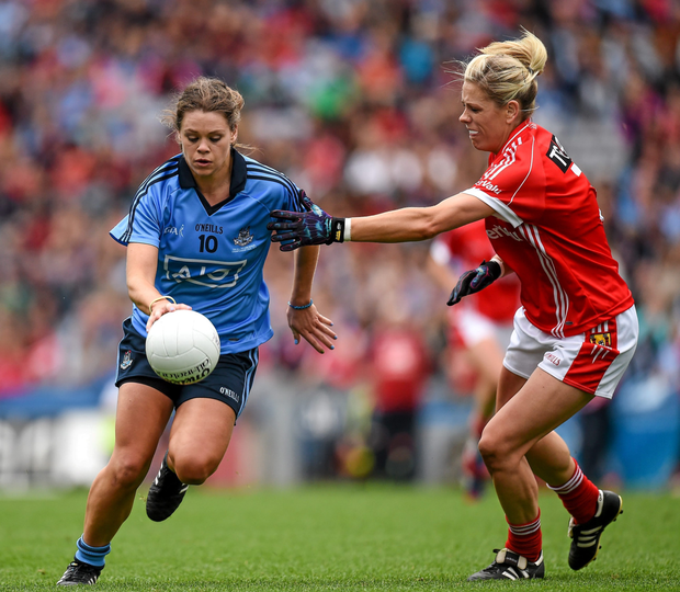 Dublin's Noelle Healy and Cork's Angela Walsh in the 2014 All-Ireland final in Croke Park Picture: Sportsfile