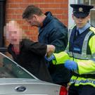 Gardai arrest a man at the scene of the assault on Darrell Hutch