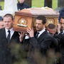 Mourners carry the coffin of 19-year-old car crash victim Kiara Baird