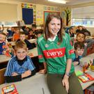 Teacher and Mayo supporter Jenny O Malley pictured her with her 3rd class pupils at St Mary's Boys National School in Lucan.