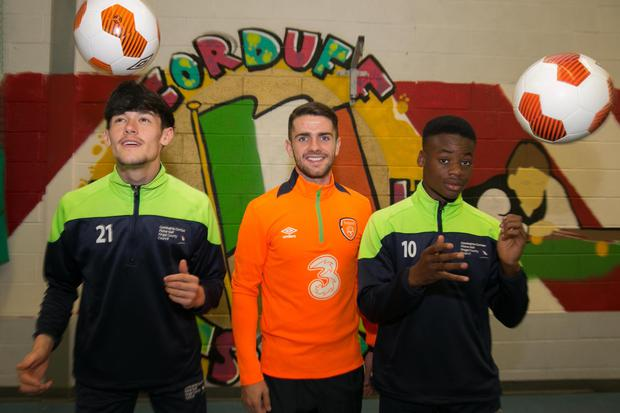 Euro 2016 hero Robbie Brady with football-mad students Cian Clarke (left) and Frankie Haaba