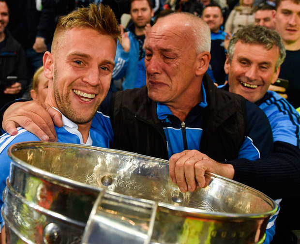Jonny Cooper of Dublin celebrates with the Sam Maguire cup and his father Brendan after the final. Photo: Sportsfile