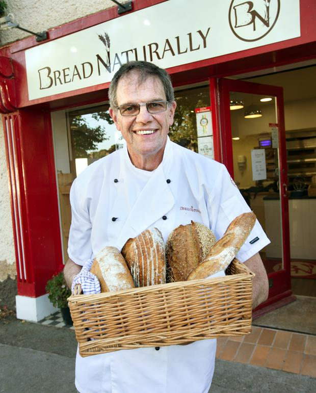 Simon May of Bread Naturally with a selection of his award-winning bread outside his shop in Raheny Picture: Tony Gavin