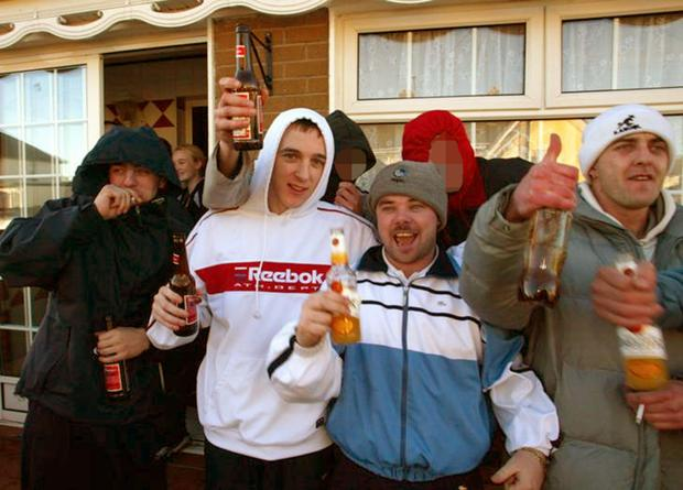 Kieran 'Rashers' Ryan in Reebok hoodie, Edward 'Eds' McCarthy in blue and white tracksuit top and convicted murderer, James McCarthy in white cap in 2003