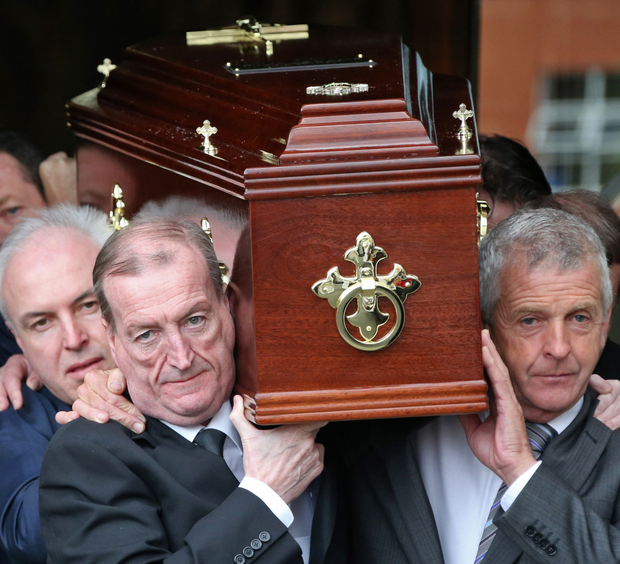 Charles Haughey's son Ciaran (front left) helps to carry the remains of his uncle, Fr Eoghan Haughey