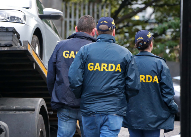 Gardai remove vehicles from a garage in the city centre