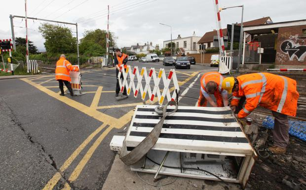 Iarnrod Eireann workers at the Merrion Gates level crossing where a car damaged a barrier causing major traffic delays back in 2013