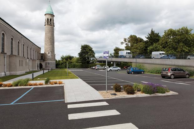 The proposed new road will pass through the grounds of Our Lady Queen of Peace Church