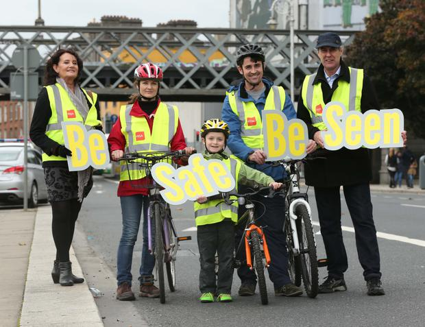 Carmel Giles (left) and Gerry Wade (right) with Robert Carey and his parents, Roslyn and Colin, as they promote the road safety campaign
