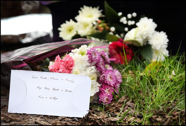 Flowers left by relatives at the sealed off road in Knockadoon outside Tom and Kitty Fitzgerald's home where their bodies were discovered.