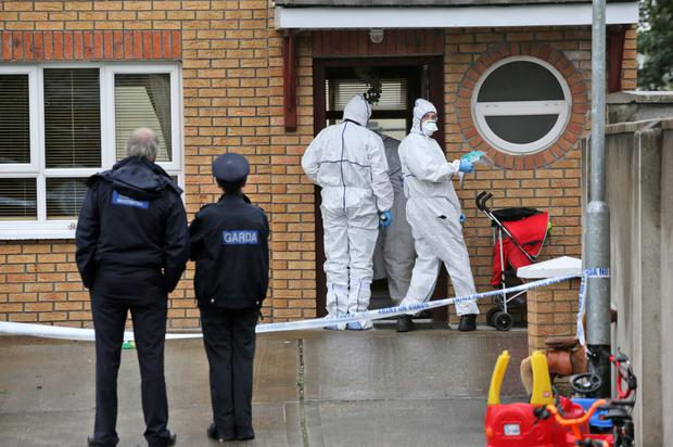 Gardai at the scene of his murder in 2012