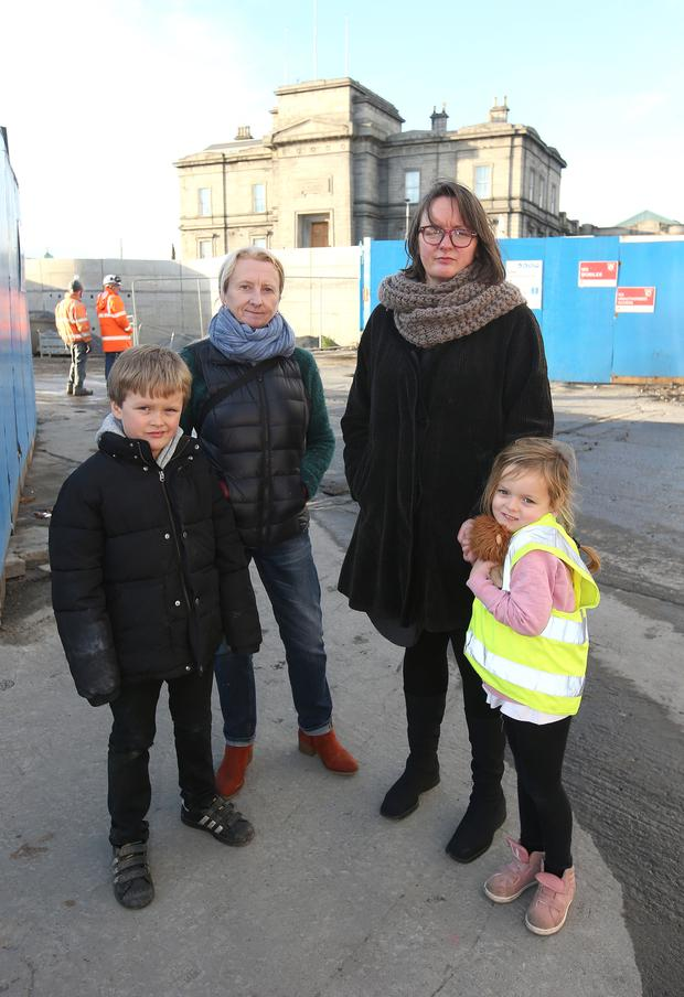 Gwen O'Dowd (second left) with Jenny O'Dunlaing and her children, Sean (7) and Rose (5), at the walled-off old station