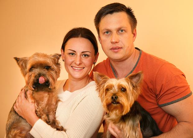 Elidas and wife Elvyra with Chance and Bucci who were saved by brave firemen Picture: Gerry Mooney