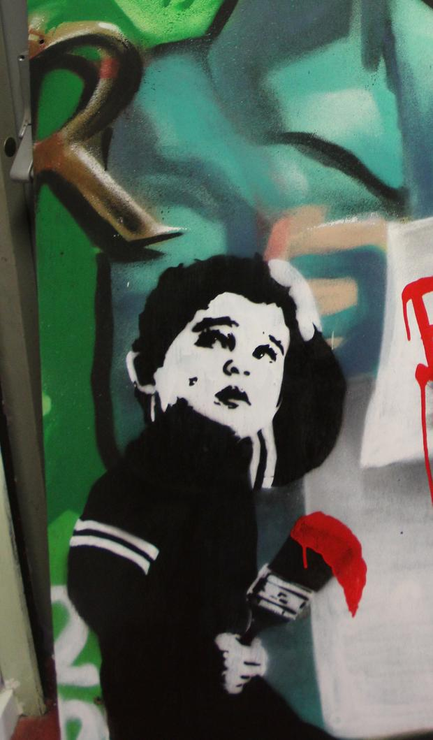 The new image, in Bansky's distinctive style, on a mural