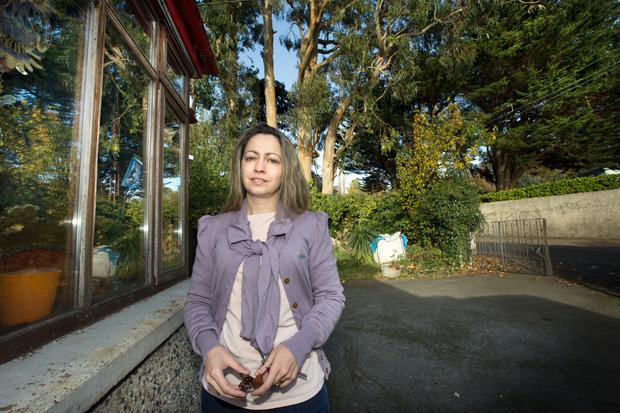 Francesca De Cataldo at her home where roots from the eucalyptus trees have damaged her garden