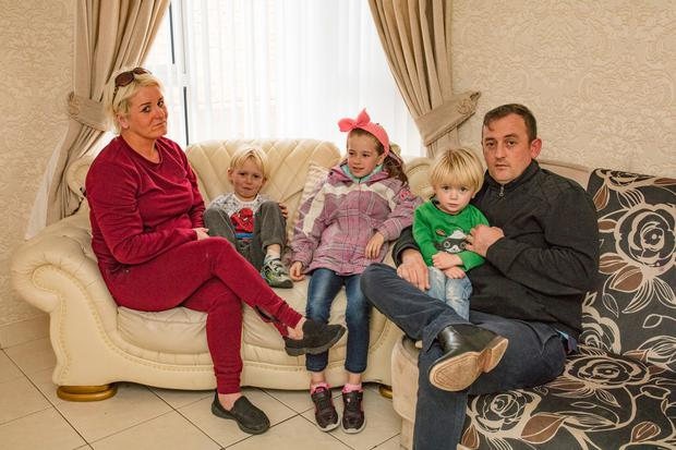Margaret and Patrick McCarthy with three of their children – Paddy (7), Mariline (8) and Bill (2) – in their Shankill home