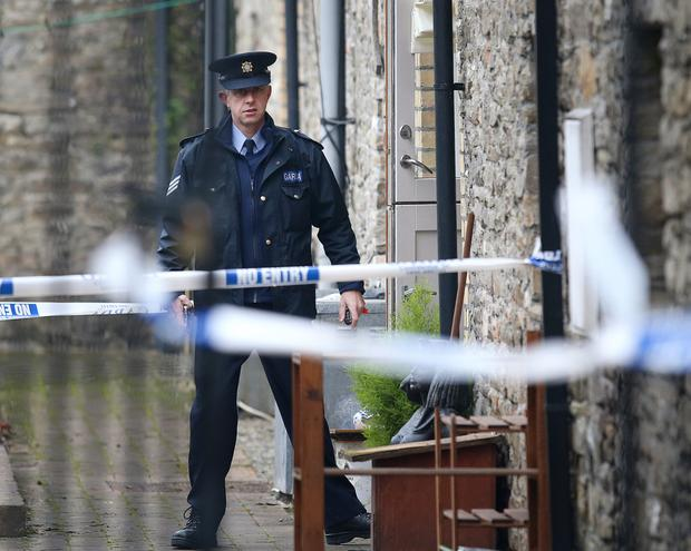 A garda outside The Maltings, where the victim was found with serious injuries