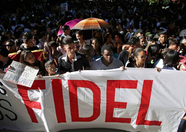 Students of Havana University pay tribute to Cuba's late President Fidel Castro as they march to Revolution Square in Havana