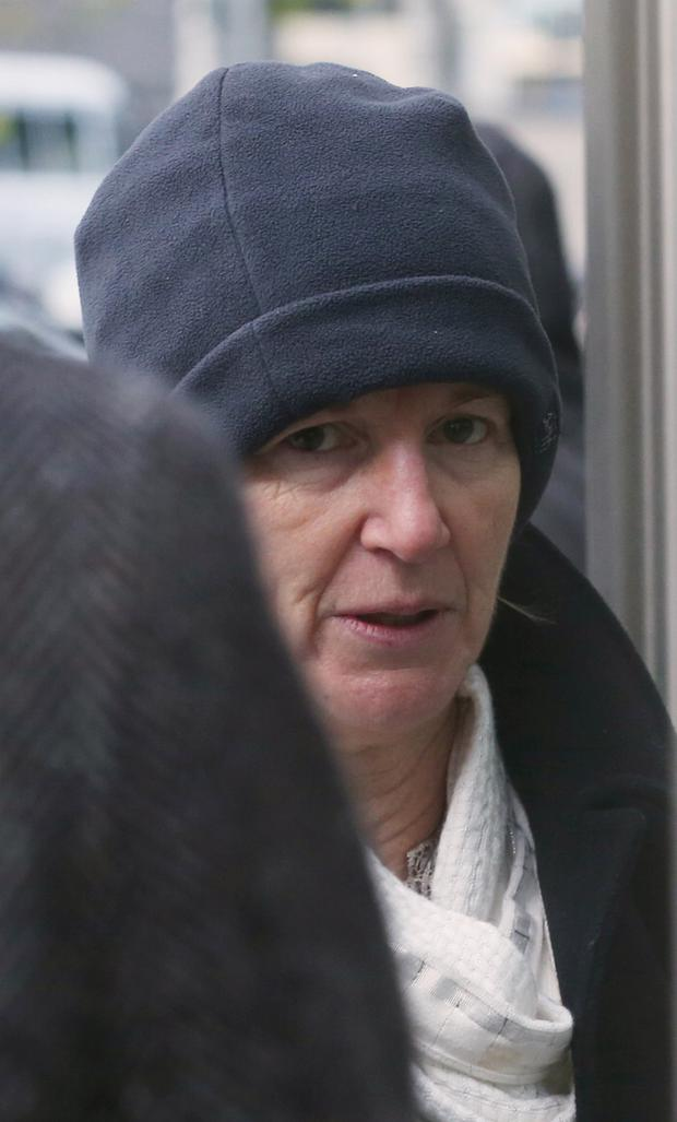 Bernadette Scully arrives at the Central Criminal Court in Dublin this morning, where she is charged with the manslaughter of her daughter, Emily Barut (11), in September, 2012. Photo: Collins Courts