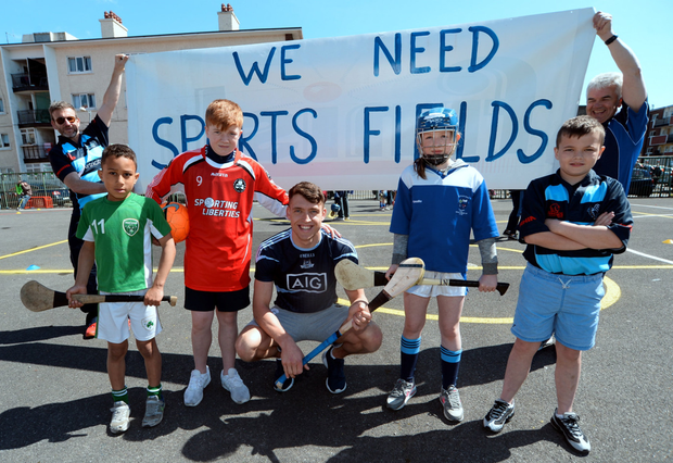 Dublin hurler Chris Crummey (centre) joins children and staff from south inner city schools and sports clubs as they campaign for proper pitch facilities