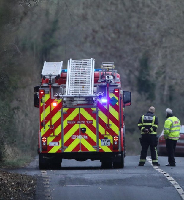 Emergency services at the scene of the crash Photo: Patrick Browne