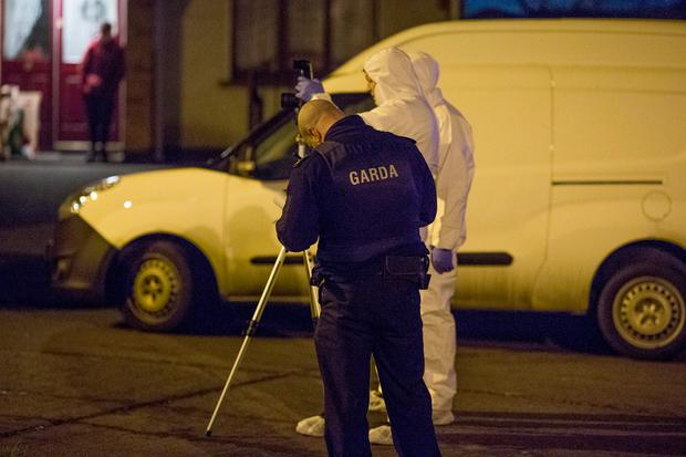 Gardai at the scene of the shooting in Mulhuddart Photo: Arthur Carron