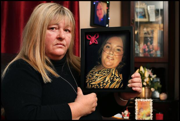 Lisa Angan holds a photo of her daughter Jessica Bingham taken 12 hours before she passed away.