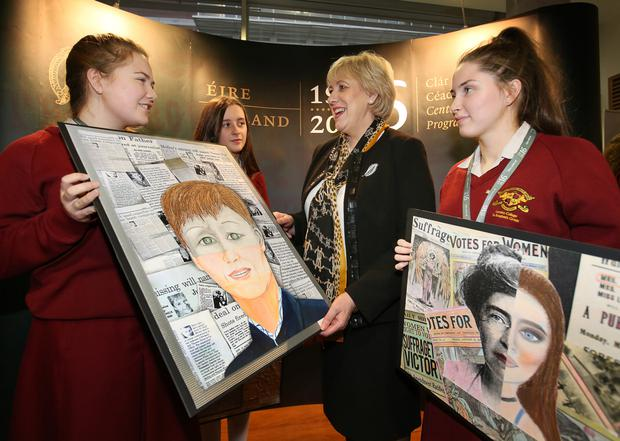 Arts Minister Heather Humphreys with Loreto College students Aine Baldrey (left) and Aine Kennedy at the National Library of Ireland