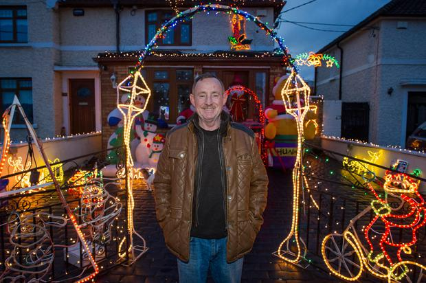 John Kelly outside his Dundrum house with his Christmas lights
