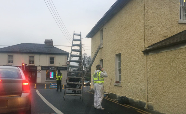 A garda manned the road closure in Cabinteely 'to ensure the painter's safety'