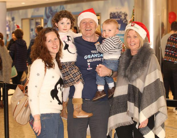 Kelly Anne Dooley pictured with kids James and Eabha and parents Tony and Corena at Dublin airport as the Christmas Commuting takes place