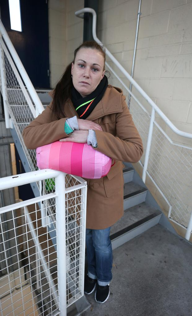 Eileen McCann pictured in the stairwell of a car park in Dublin where she sleeps at night