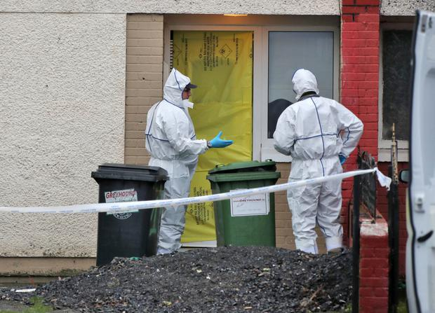 Gardai examine the scene in Tallaght where 16-year-old Reece Cullen (left) was killed last week