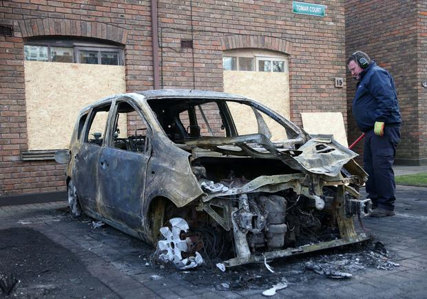 One of the fire-ravaged cars in Tomar Court Picture: Collins
