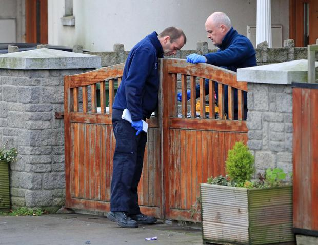 Gardai examine the scene in Balcurris Park West, Ballymun