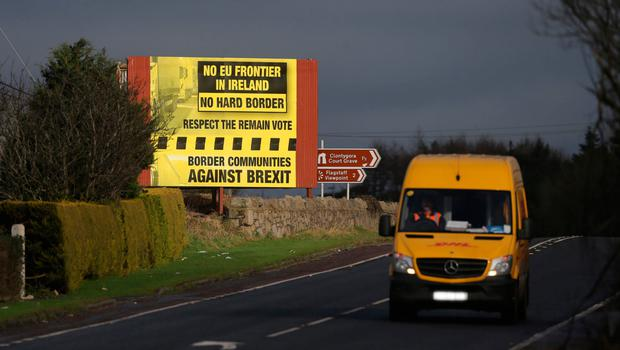 A delivery van passes a Brexit billboard in Jonesborough, Co. Armagh