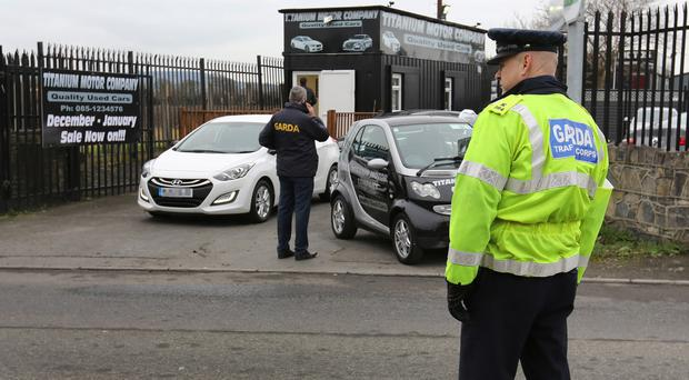 Gardai joined the early morning raid, during which cars were loaded on to transporters