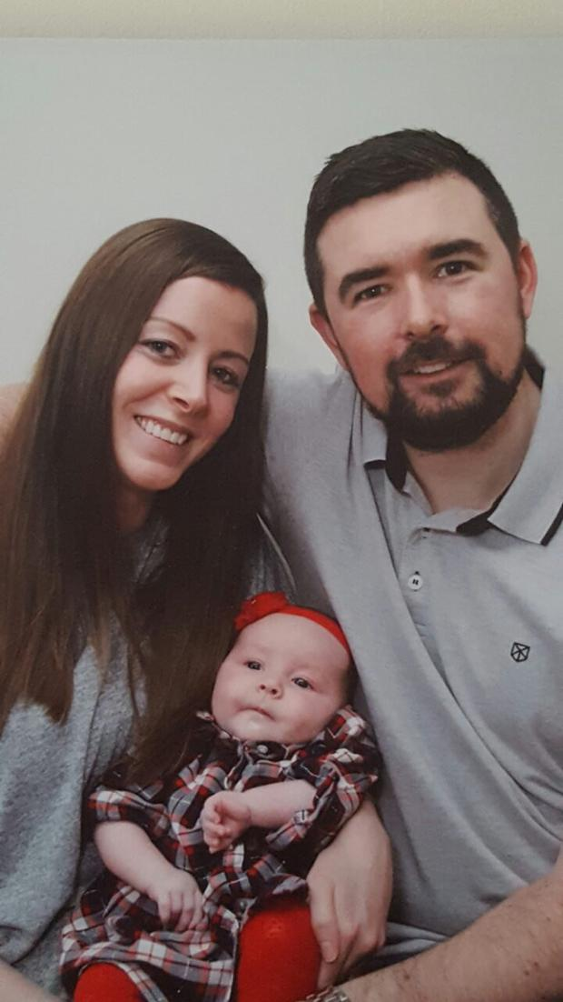 Lara McHugh's (4 months) is pictured with her father David McHugh and her mother Celine Power