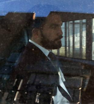 Michael Halloran (29) leaves court after his damages hearing