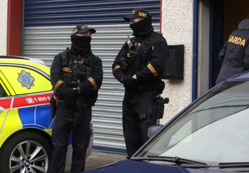 Gardai at the premises in Baldonnel where 3 men were arrested and a host of weapons found