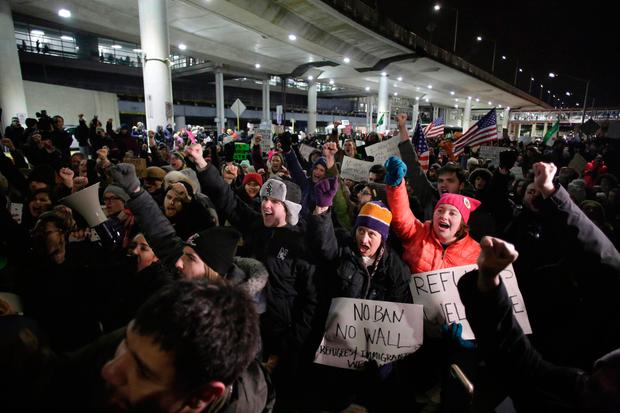 Americans at Chicago O'Hare Airport protest against the 'Muslim ban' imposed by Donald Trump