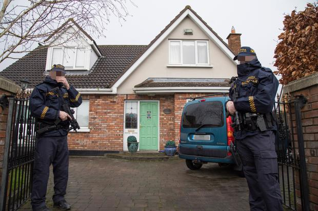 The raided bungalow in Sallins, Co Kildare, sealed off by armed officers