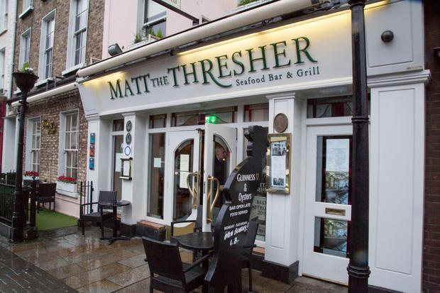 Emergency crews work to make safe a roof after it was blown on to Matt The Thresher pub